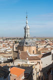 A panoramic view to spanish town Consuegra. Castilla-La Mancha and a church over the orange tile roofs on sunny day Royalty Free Stock Photo