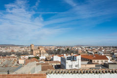 A panoramic view to spanish town Consuegra. Castilla-La Mancha over the orange tile roofs on sunny day Stock Image