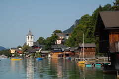 Panoramic view to St. Wolfgang, Austria. A panoramic view to St. Wolfgang located at the Wolfgangsee. The Wolfgangsee is a mountain lake in the Salzkammergut in Stock Photos