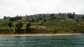 Panoramic view to Taquile island coastline at Titicaca lake, Puno, Peru. Panoramic view to Taquile island coastline at Titicaca lake in Puno, Peru royalty free stock images