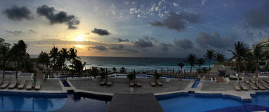 Panoramic view to the tropical resort at sunrise time Royalty Free Stock Photos