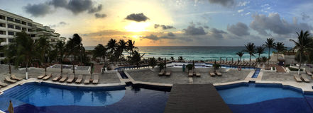 Panoramic view to the tropical resort at sunrise time Stock Photos