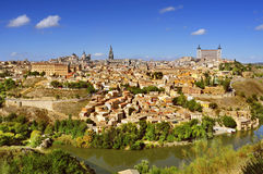 Panoramic view of Toledo, Spain, and the Tagus river. A panoramic view of Toledo, Spain, with the Tagus river in the foreground and the imposing Alcazar in the Stock Image