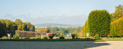Panoramic view from the top of a classical garden. On a clear day in Autumn Stock Images