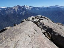 Standing at the edge of Moro Rock overlooking snowy mountains and valleys - Sequoia National Park. Panoramic View from the Top of Moro Rock overlooking Mountains stock photo