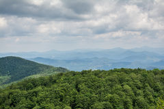 Panoramic view from the top of mountain to many mountain peaks around Royalty Free Stock Image
