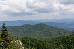 Panoramic view from the top of mountain to many mountain peaks around Royalty Free Stock Images