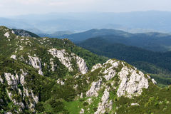 Panoramic view from the top of mountain to many mountain peaks around Stock Images