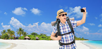 Panoramic view of tourist taking selfie on a beach Royalty Free Stock Photo