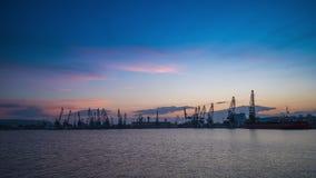 Panoramic view toward sea port and industrial cranes, Varna, Bulgaria. Colorful sunset over sea port and industrial cranes, Varna, Bulgaria stock footage