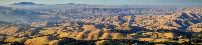 Panoramic view towards Mount Diablo at sunset from the summit of Mission Peak. San Francisco bay area, California; golden hills and valleys Royalty Free Stock Photo