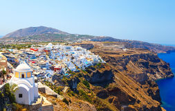 Panoramic view of the town of Fira, famous picturesque white houses on a high slope near the sea, Santorini, Greece Royalty Free Stock Photos