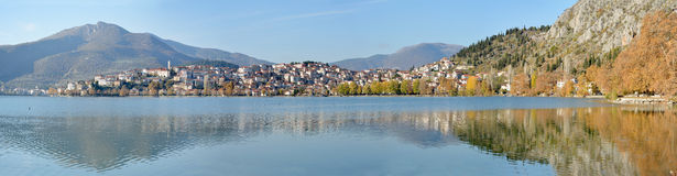 Panoramic view of town with lake in autumn Royalty Free Stock Image
