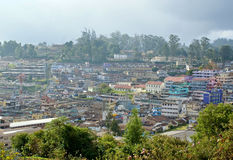 Panoramic view of a town settled on hill. Panoramic and scenic view of a hill station located in South India , shot from an elevated land mass Stock Photos