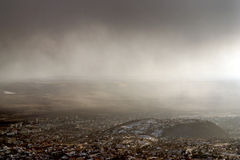 Panoramic view on town in snowstorm coming. Royalty Free Stock Photography