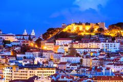 Lisbon by night, Portugal. Panoramic view with traditional architecture of Lisbon illuminated in evening lights in Portugal Royalty Free Stock Photos