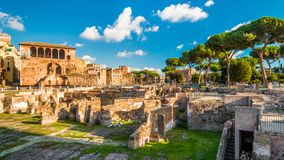 Panoramic view of Trajan`s Forum in summer, Rome, Italy. Trajan`s Forum is one of main tourist attractions in Rome. Ancient Roman ruins in central Rome Stock Image