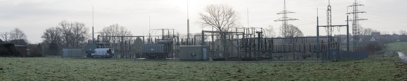 Panoramic view of a transformer substation on the edge of an arable land, much free space and width as a header for a website. Stitched Royalty Free Stock Image