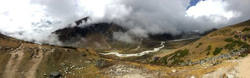 Panoramic view of trekking trail with river valley below Stock Photography