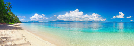 Panoramic view of tropical beach on background the islands. Panoramic view of a tropical beach against the backdrop of the island of Sulawesi. Indonesia Royalty Free Stock Images