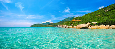 Panoramic view of a tropical beach. Royalty Free Stock Photos
