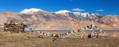 Panoramic view of Tso Moriri Lake with prayer flags Royalty Free Stock Images