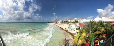 Panoramic view of turquoise beach, hotels and bar royalty free stock photo