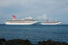 Panoramic view of two cruise ships. Two modern white cruise ships bring travelers to exotic port of call in the Caribbean royalty free stock photography