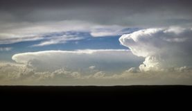 Panoramic view of two supercell thunderstorms near the border of Nebraska and Wyoming, United States of America. Beautiful rotating thunderstorms on the high stock images