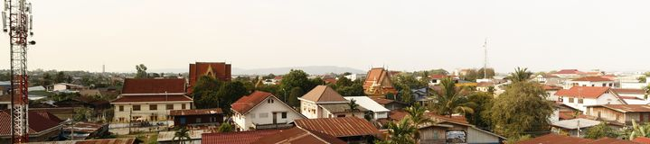 Panoramic view of a typical southeast asian town, with temples and iron roofs, Laos. Southeast Asia Stock Images