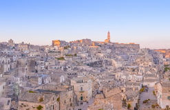 Panoramic view of typical stones and church of Matera and the Madonna de Idris under begin sunset sky Stock Photo