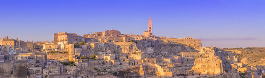 Panoramic view of typical stones and church of Matera and the Madonna de Idris under begin sunset sky Royalty Free Stock Image