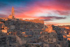 Panoramic view of typical stones and church of Matera and the Madonna de Idris under sunset sky Stock Photo