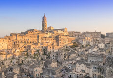 Panoramic view of typical stones and church of Matera under begin sunset sky Royalty Free Stock Photo