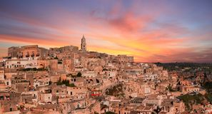 Panoramic view of typical stones and church of Matera under sunset sky Royalty Free Stock Photos