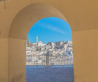 Panoramic view of typical stones Sassi di Matera and church of Matera under arcade. Basilicata, Italy Stock Image