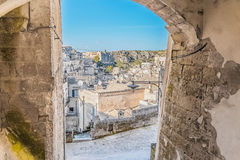 Panoramic view of typical stones Sassi di Matera and church of Matera under arcade. Basilicata, Italy Royalty Free Stock Photos