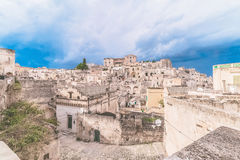 Panoramic view of typical stones Sassi di Matera and church of Matera under blue sky Stock Photography