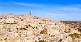 Panoramic view of typical stones (Sassi di Matera) and church of Matera under blue sky Royalty Free Stock Photos