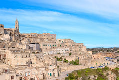 Panoramic view of typical stones (Sassi di Matera) and church of Matera under blue sky Stock Photography
