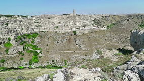 Panoramic view of typical stones Sassi di Matera and church of Matera under blue sky. Basilicata. Italy stock video footage
