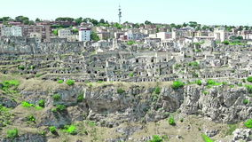 Panoramic view of typical stones Sassi di Matera and church of Matera under blue sky. Basilicata, Italy, zoom out camera. Movement stock video