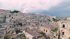 Panoramic view of typical stones (Sassi di Matera) and church of Matera under blue sky stock video footage