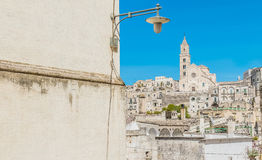 Panoramic view of typical stones Sassi di Matera with church in Matera UNESCO European Capital of Culture 2019 on blue sky Royalty Free Stock Photos
