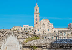 Panoramic view of typical stones Sassi di Matera with church in Matera UNESCO European Capital of Culture 2019 on blue sky Royalty Free Stock Images