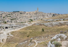 Panoramic view of typical stones Sassi di Matera and church of Matera UNESCO European Capital of Culture 2019 under blue sky. Ba Stock Photo