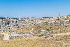 Panoramic view of typical stones Sassi di Matera and church of Matera UNESCO European Capital of Culture 2019 under blue sky. Ba Stock Photos