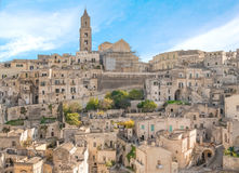 Panoramic view of typical stones (Sassi di Matera) and church of Matera UNESCO European Capital of Culture 2019 under blue sky Stock Image