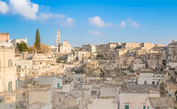 Panoramic view of typical stones (Sassi di Matera) and church of Matera UNESCO European Capital of Culture 2019 under blue sky Royalty Free Stock Photo