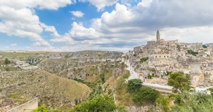 Panoramic view of typical stones Sassi di Matera and church of Matera UNESCO European Capital of Culture 2019 under blue sky stock video footage